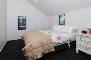 A bed or beds in a room at Charming Inner City Holiday Home