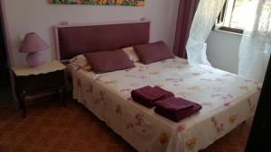A bed or beds in a room at Casa Marieva