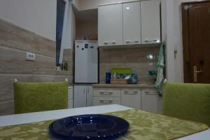 A kitchen or kitchenette at MK apartments 2