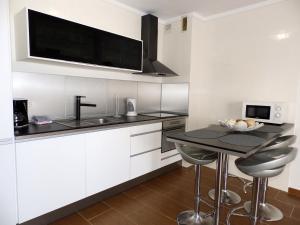 A kitchen or kitchenette at Apartamento Boheme