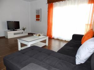 A television and/or entertainment center at Apartamento Boheme
