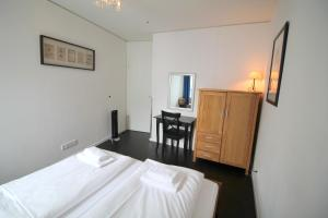 A bed or beds in a room at Holiday at Alexanderplatz Apartments