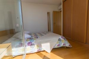 A bed or beds in a room at Atlantic Sagres