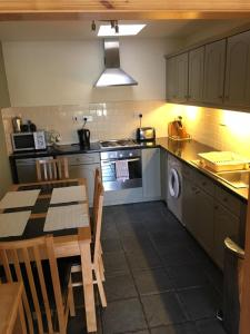A kitchen or kitchenette at Harbour View Apartment