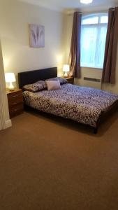A bed or beds in a room at Latium Close 11