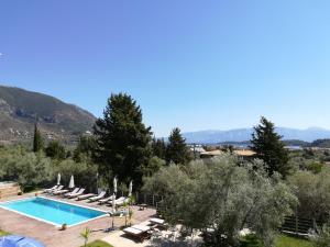 Θέα της πισίνας από το Golden Sun Villas  ή από εκεί κοντά