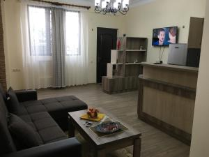 A seating area at Suite Gold Apartment