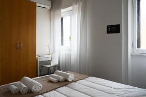 A bed or beds in a room at Le Terrazze a Ponte Milvio