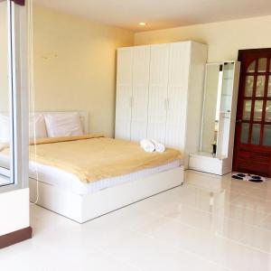 A bed or beds in a room at Home In Samui