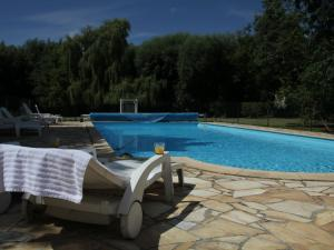 The swimming pool at or near Le Chalet En Bois 2