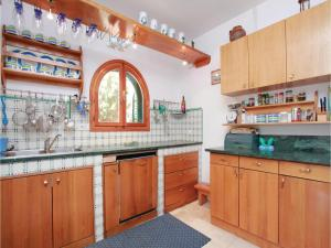 A kitchen or kitchenette at Holiday Home Prizba with Sea View 02