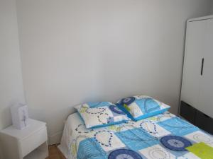 Un ou plusieurs lits dans un hébergement de l'établissement Appartement de charme à la montagne