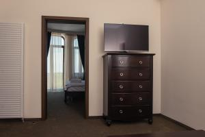 A television and/or entertainment center at Old City - Apartments