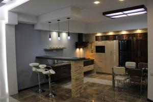 A kitchen or kitchenette at Apartament SportPalace