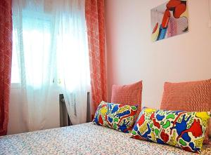 A bed or beds in a room at Gifsa Sanse Apartment