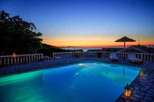 The swimming pool at or close to Villa Quietude, beach front villa with a pool