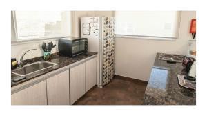 A kitchen or kitchenette at Casa Ba Haus