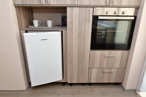 A kitchen or kitchenette at City Premium Apartments