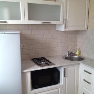 Кухня или мини-кухня в Апартаменты ЦУМ
