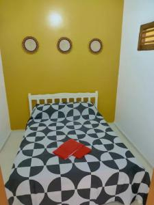 A bed or beds in a room at Vila Areia