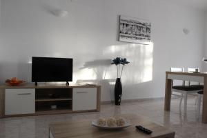A television and/or entertainment center at Villa Figueira