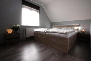 A bed or beds in a room at Samostatný luxusní dům