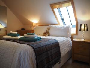 A bed or beds in a room at Decca - Self Catering Shetland