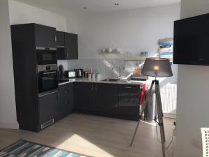 A kitchen or kitchenette at Marine Terrace Apartments