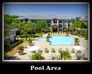 A view of the pool at (1512) Walk to NRG, 2/2 Apt. Sleeps 10. or nearby