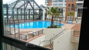 A view of the pool at Departamento Puerto Pacifico or nearby