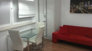 Ein Sitzbereich in der Unterkunft Apartament Sokołowska