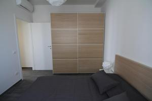 A bed or beds in a room at Appartamento zona Torregalli_Nuvola Viola