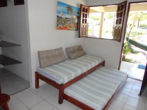 A seating area at Flat do Golfinho