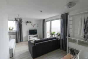 Ruang duduk di Ansbachs City Apartment