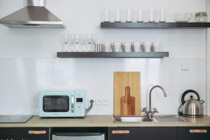 A kitchen or kitchenette at Boutique Apartments Possonium