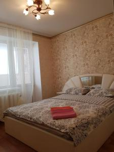Кровать или кровати в номере Apartment Lenina 201