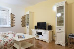 A television and/or entertainment center at Sweet Home At Dunajska St.