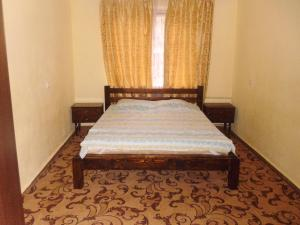 A bed or beds in a room at Apartment on Machavariani 34