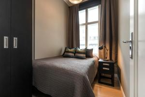 A bed or beds in a room at Josefinesgate Apartments