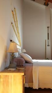 A bed or beds in a room at Amplio Loft-Dúplex Sevilla