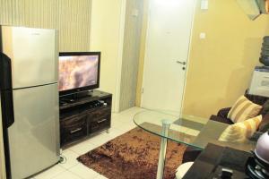 A television and/or entertainment center at Apartemen Kalibata City