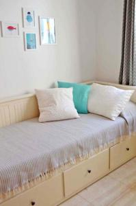 A bed or beds in a room at Apartamento Dacil