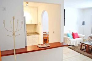 A kitchen or kitchenette at Apartamento Dacil