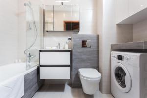 Vonios kambarys apgyvendinimo įstaigoje InPoint Tauron Arena Apartment