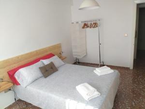 Cama o camas de una habitación en Apartamento Ciudad Jardín