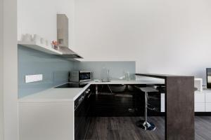 A kitchen or kitchenette at The Riverview Apartment