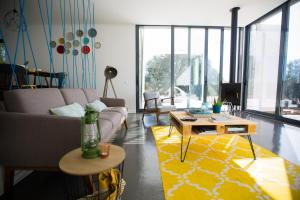 A seating area at casa singular | concept house