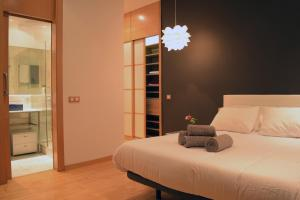 A bed or beds in a room at Madrid Suites Gran Via