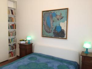 A bed or beds in a room at Talenti home Casa Luna