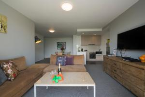 A seating area at Quest Flemington Apartment Hotels